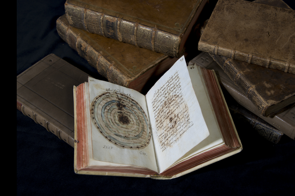 Astronomical manuscript open to a page showing a paper instrument.