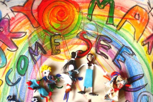 Story Makers artwork featuring a rainbow and many colourful characters
