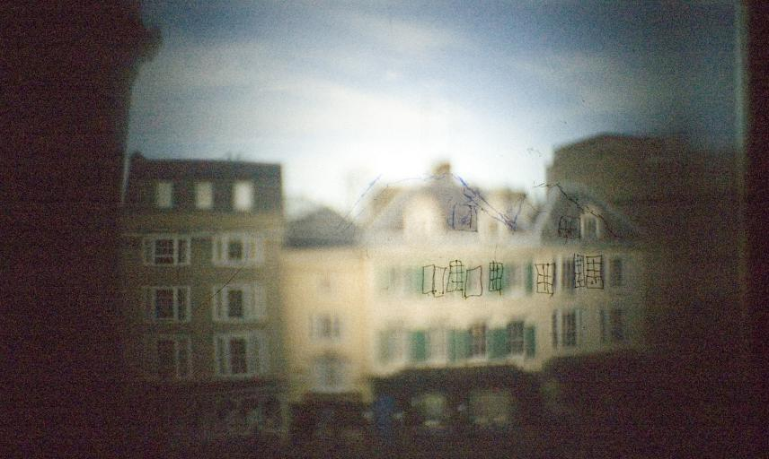 The view through a camera obscura of buildings across the street from the Museum. The view is very fuzzy.